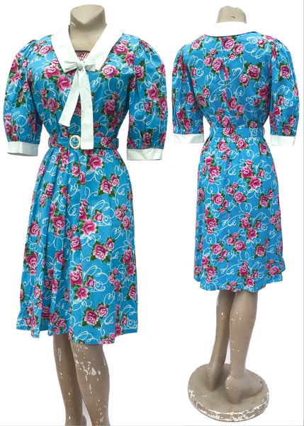 Vintage 80s summer cotton dress, turquoise with pink carnations print. White collar and cuffs with white bow tie