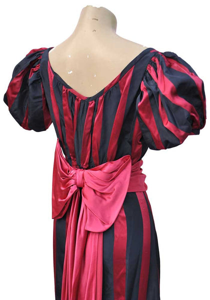 puffed balloon statement sleeves with a fuscia pink bow and swags