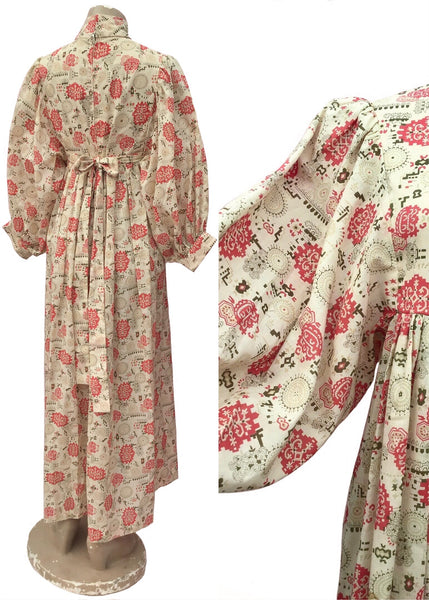 Balloon sleeve maxi prairie dress in beige cotton with a red pattern print, and high neck victorian style