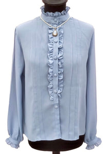 pale dusky blue ruffle blouse with piecrust collar, covered buttons and a frill front