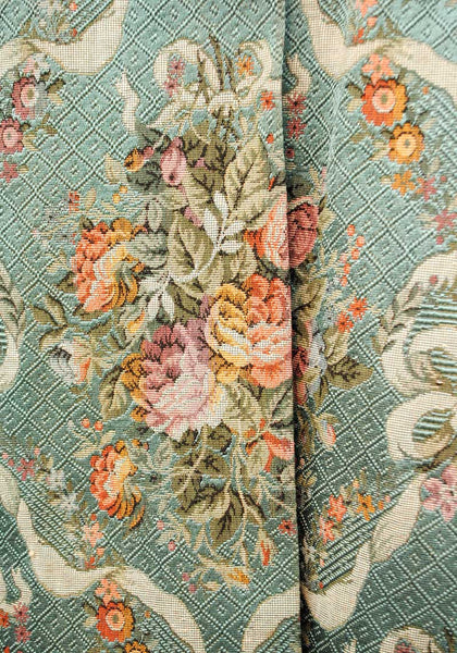 blue tapestry with roses and swags