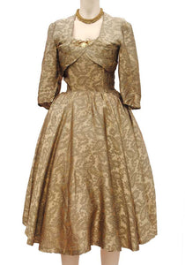 1950s vintage gold fit and flare cocktail dress, full skirt