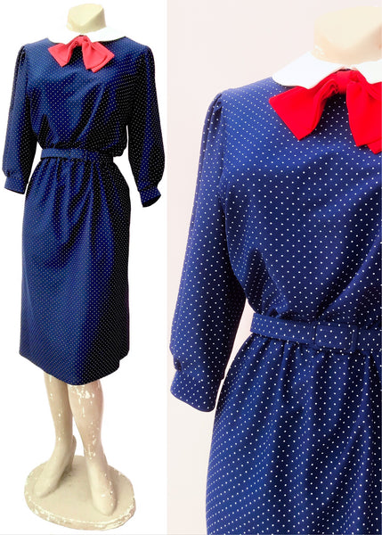 Late 70s blue spotty diana dress with peter pan collar and red bow, matching belt at the waist