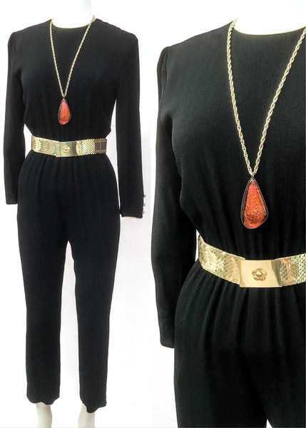 Vintage disco, Black crepe long sleeve jump suit with gold piping at the neckline and sleeve cuffs