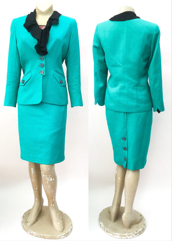 Favoured by british royalty, designer caroline charles turquoise skirt suit.