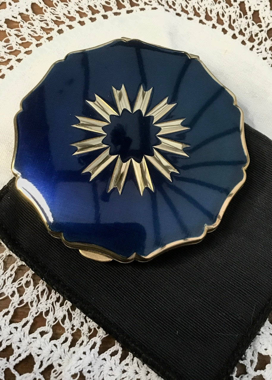 beautiful gift ideas for women with vintage collectible powder compact cases, this one has a lovely deep blue and silver polished front.