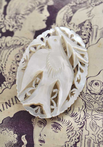 vintage mother of pearl dove of peace brooch