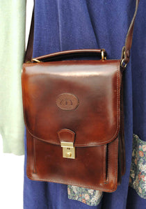 buy vintage messenger bag with loads of compartments and lockable closure, very steampunk.