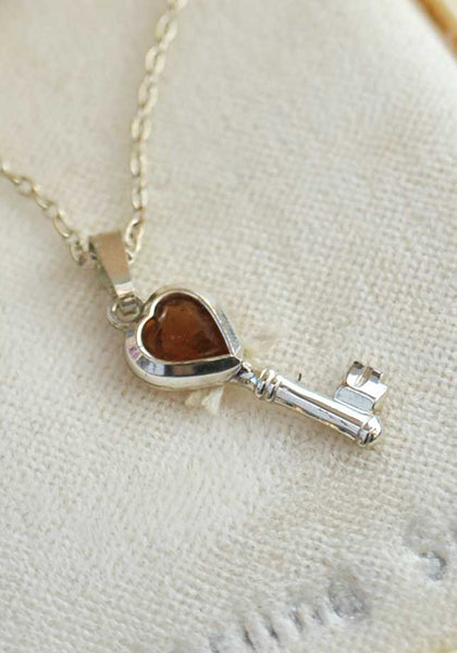 vintage silver key charm necklace with topaz gemstone
