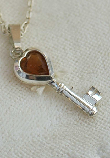 sterling silver and topaz charm of a key with loveheart
