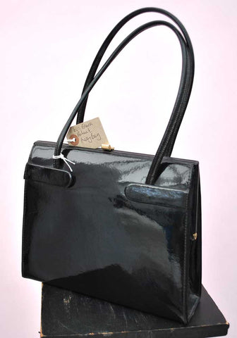 black patent kelly bag