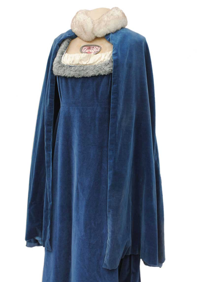 blue velvet cape with faux fur collar pictured on a medieval velvet wedding dress