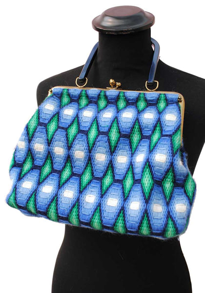 1960s woven wool handbag in green and blue geometric design with a blue pearl lucite handle