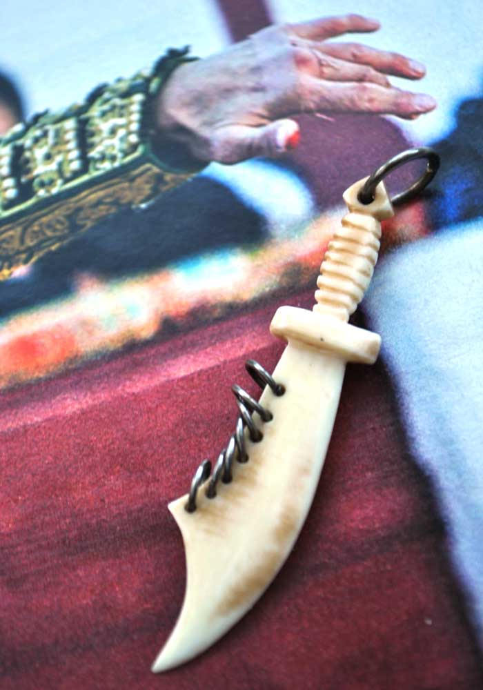 vintage carved bone cutlass dagger pendant charm