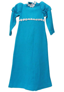 little girls vintage turquoise bridesmaid maxi dress in a medieval style with leg of mutton sleeves, made with a waffle fabric
