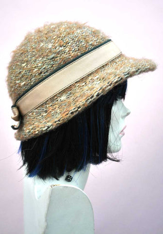 green knitted cloche hat with crossgrain bow