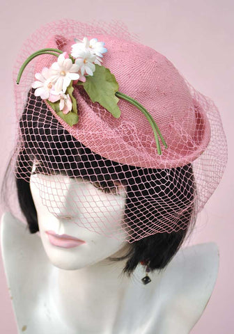 pink straw vintage wedding hat with flowers and net veil