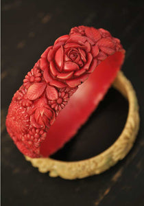 1930s red carved celluloid floral bangle