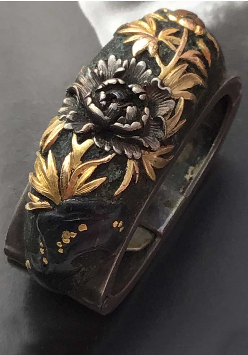 1800s Japanese Meiji period fuchi with crysanthemum in mixed metals gold silver and black