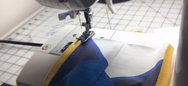 pouch being sewn on sewing machine