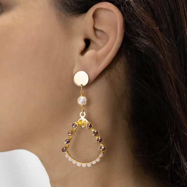 Adilah Earrings on a model. Gold Color Earrings with dark pink iridescent Crystal Beads, fresh water pearl & seed bead crystals. Metal Frame & Wire Wrapped Earrings