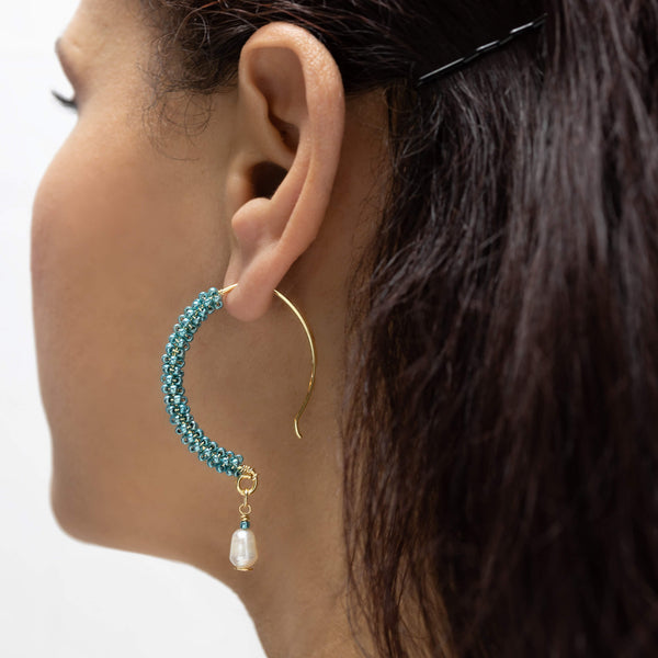 Ancora Gold Hoop Earrings on a model. Gold Color Earrings with Aqua  Seed Beads  Crystals. Wire Wrapped Earrings.