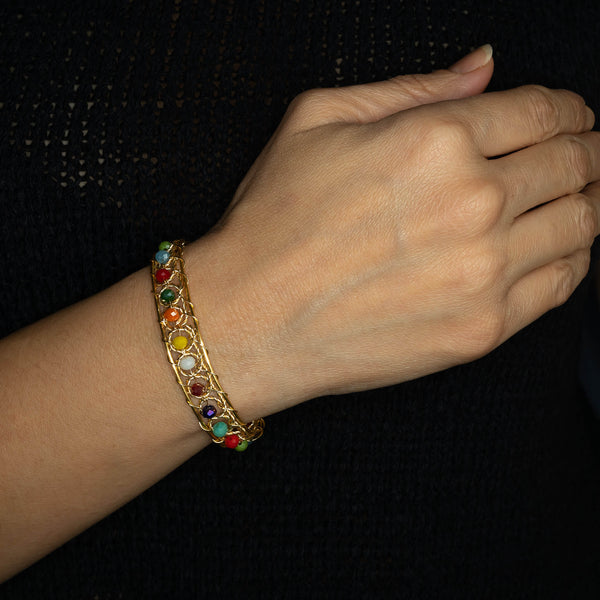 Aurich Bracelet on a model. Gold Color  Bracelet with Multicolor beads crystals. Wire wrapped bracelet.