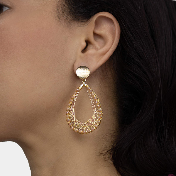 Barsha  Earrings  on a model.  Gold Color Earrings with Peach Crystal Beads. Dangle Earrings.