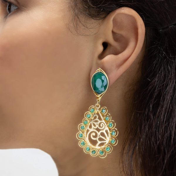 Ekani  Earrings on a model.  Gold Color Earrings with Green Crystals . Stud Earrings. Metal Frame & Wire Wrapped Earrings