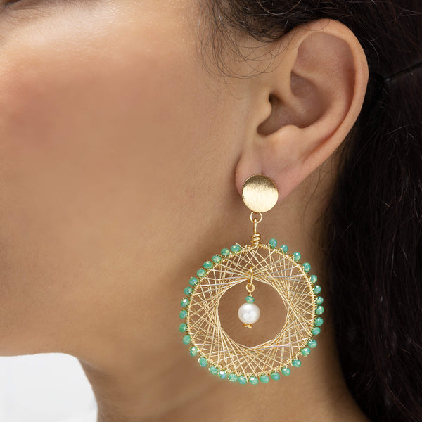 Farida Earrings on a model. Gold Color Earrings with Lime green Crystal Beads. and Fresh Water Pearls. Stud Earrings. Wire Wrapped Earrings.