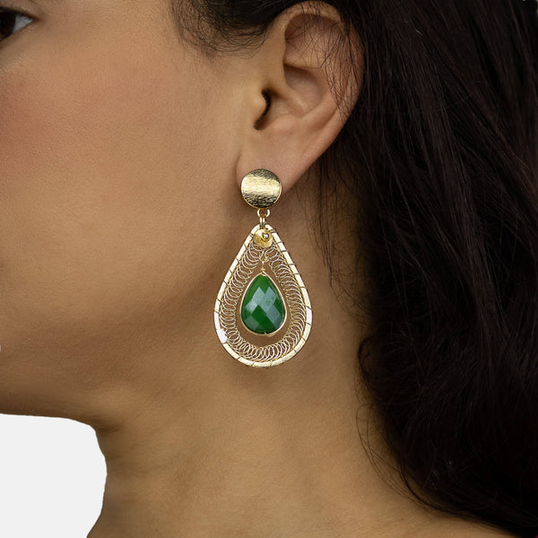 Ganika Earrings on a  model. Gold Color Earrings with Green Teardrop Crystal. Stud Earrings. Metal Frame & Wire Wrapped Earrings.