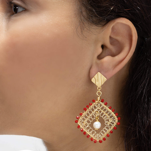 Myra Earrings on a model. Gold Color Earrings with Red Czech Seed Bead Crystals and fresh water pearls. Stud Earrings. Wire Wrapped Earrings