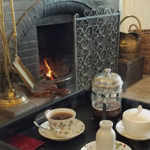 Cozy hearth with coffee and teacups