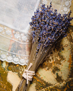 Lavender bouquet on lace linens