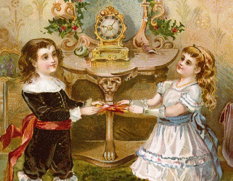 Victorian children with a Christmas cracker
