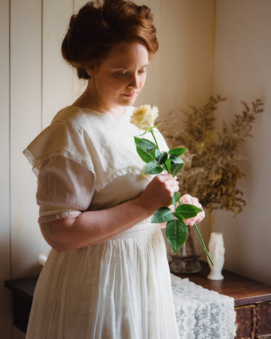 Anna Krusinski of Willow & Birch Apothecary shop in vintage Victorian timeless, romantic, feminine dress with English garden rose. Inspired by Jane Austen, Downton Abbey, and English cottage style.