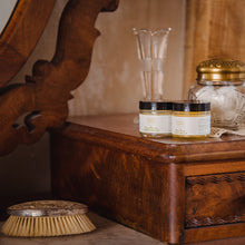 Natural moisturizing face cream set with Rose Petals Day Cream and Sweet Dreams Night Cream from Willow & Birch Apothecary on antique vanity with antique perfume bottles