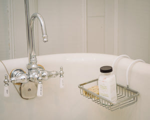 Natural epsom bath salts and scented soap by Willow & Birch Apothecary on antique clawfoot bath tub