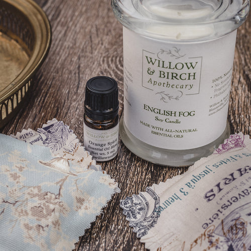 Natural home fragrance with scented soy candle, essential oil blend, and lavender scented sachets from Willow & Birch Apothecary