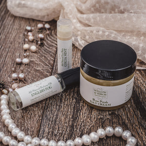 Everyday beauty set including Rose Petals Day Cream face moisturizer, natural perfume oil made with essential oils, and moisturizing natural flavored lip balm from Willow & Birch Apothecary