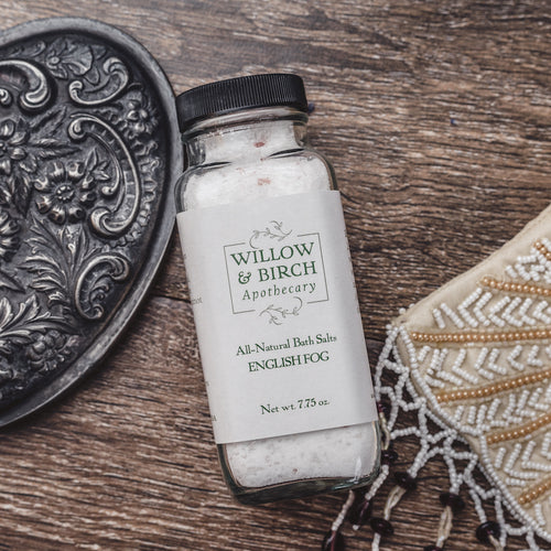 English Fog scented natural bath salts botanical epsom soak made with essential oils by Willow & Birch Apothecary with antique hand mirror and beaded Victorian style purse