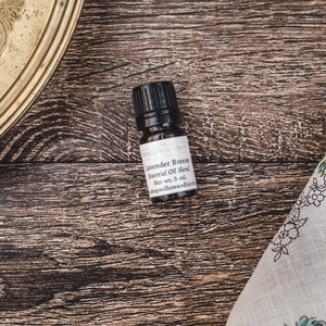 Lavender Breeze essential oil natural scent blend with lavender, clary sage, and peppermint by Willow & Birch Apothecary with antique gold vanity tray and vintage handkerchief