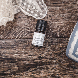 Lemon Zen essential oil natural scent blend with lavender and lemongrass by Willow & Birch Apothecary with antique blue trinket box and antique lace