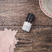 English Fog essential oil natural scent blend with bergamot, clove, and ylang ylang by Willow & Birch Apothecary with antique teacup and vintage lace