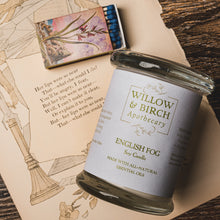 English Fog natural scented soy candle made with essential oils from Willow & Birch Apothecary with antique mirror and antique style matchbook on antique book page