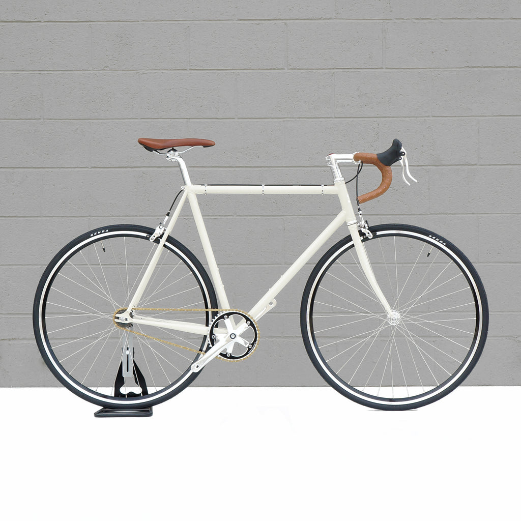The ultimate in steel bicycle frame construction is our beautiful, lightweight vintage white lugged frame, formerly the basis of the Wabi Special. Lugged steel bike frames offer a road feel unlike any other design, but not all lugged steel frames are created equal. The Wabi Retro is a purist's single-speed road bike.