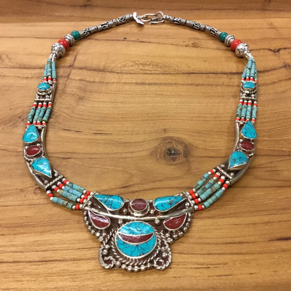 Nepalese Four Strand Beaded Necklace with Howlite Encased Metal Embellishments