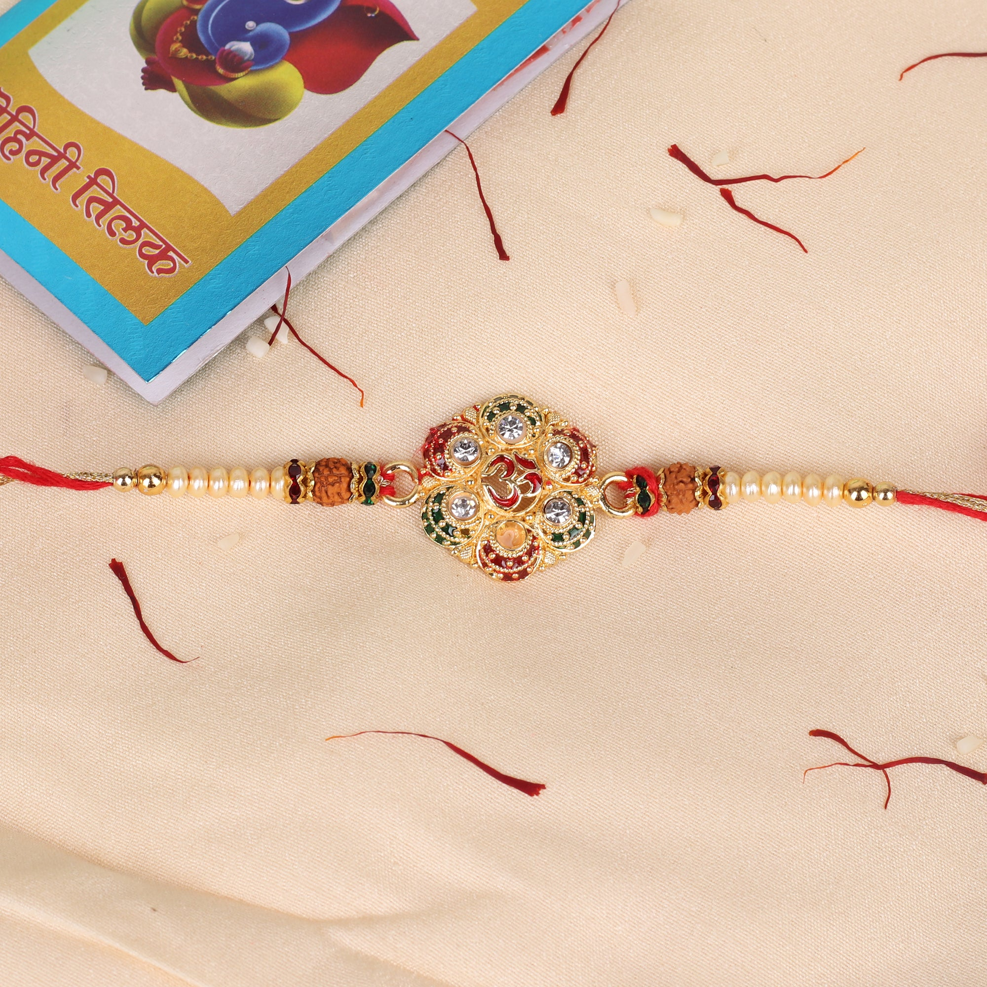 The Sparkling Studded Om Rakhi