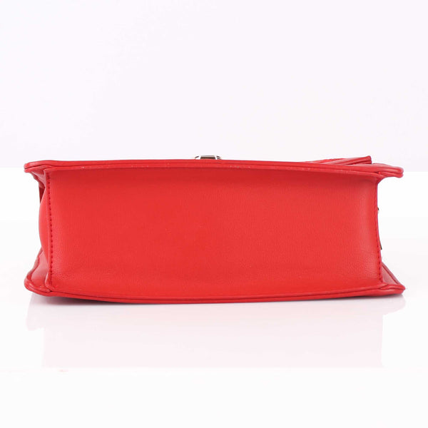 The Punched Sling Bag in Red