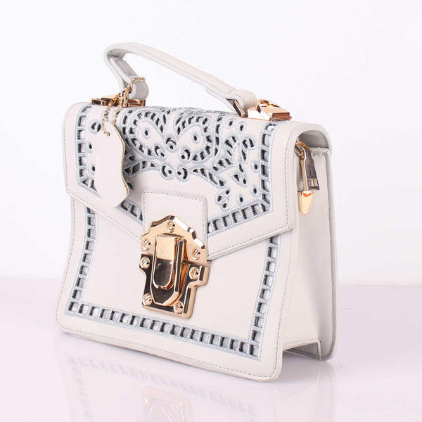 The Punched Sling Bag in White